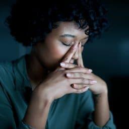 Woman experiencing sinus pressure.
